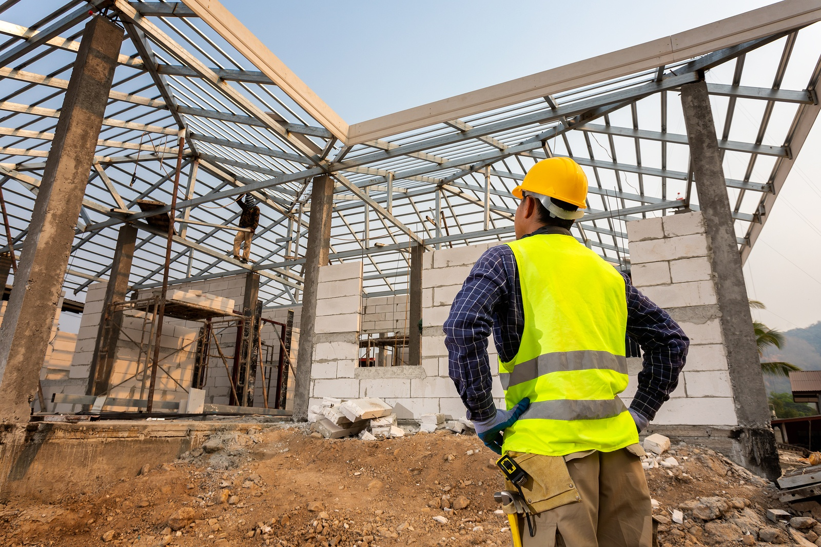 construction engineer worker,Civil engineer checking work at the construction site, House construction concept.